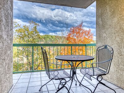 Photo for Riverfront condo w/ shared seasonal pool & gas fireplace - in the heart of town!