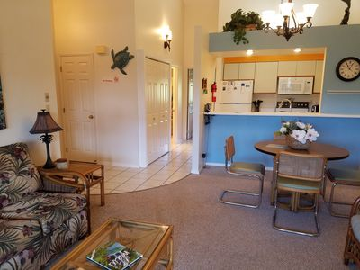 Entry, hall, and kitchen, newly painted area. Vaulted ceilings