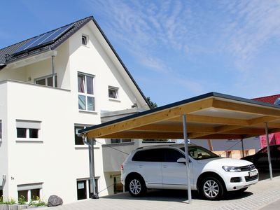 Photo for Modern Non smoking apartment in Meersburg with carport, south-facing terrace, lawn