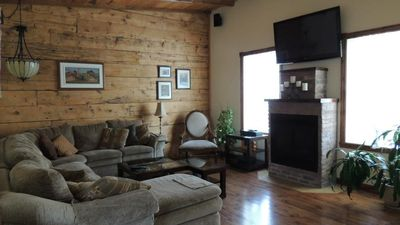 Exposed original wall, gas fireplace. 22x 15 ft living area