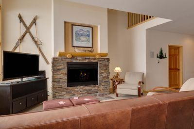 Large stone fireplace and entertainment center