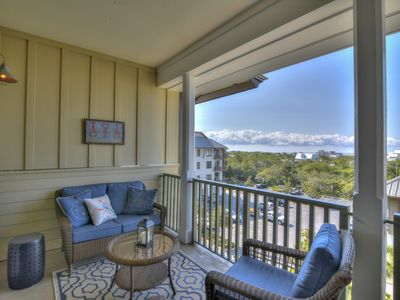Photo for Lovely condo w/ a shared gym, pool, private beach access, & shuttle service