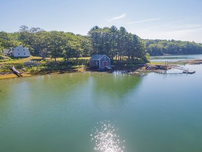 Photo for NEW LISTING! Dog-friendly lakeside cottage w/ boathouse & private boat dock!