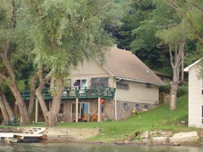 Photo for Lake front cottage with 112 foot lake beach, boat lift and dock. In renovation!