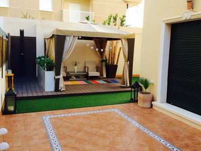 Photo for Design apartment, with a private terrace of 140 meters 20 meters from the sea and parking