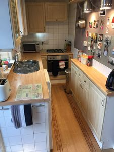 Small galley style kitchen with all necessary equipment, incl washer/dryer