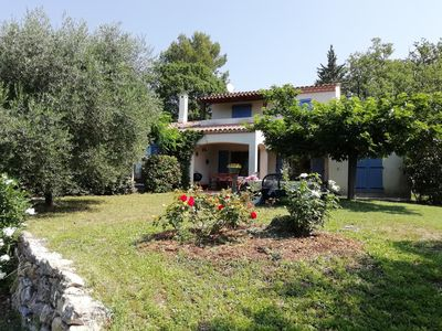 Photo for Villa with heated and covered pool. View of the village and olive grove