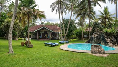 Photo for Stunning beachfront holiday villa with wonderful pool and garden