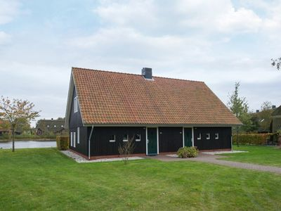Photo for 10-person farmhouse in the holiday park Hof van Saksen - on the water/recreation lake