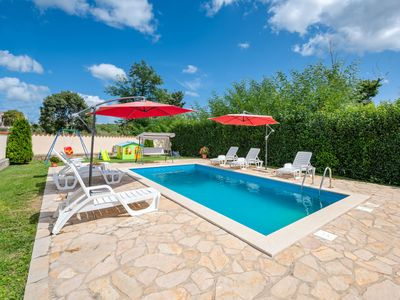 Photo for This 4-bedroom villa for up to 10 guests is located in Porec and has a private swimming pool, air-co
