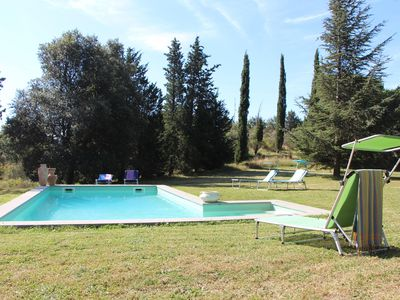 Photo for Exquisite 16th C. farmhouse w/ private pool amidst woodlands + olive groves