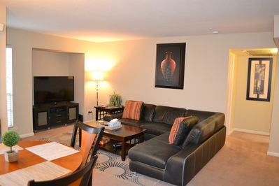 """Open Space Living Room w/ Leather Sectional and 55"""" TV"""