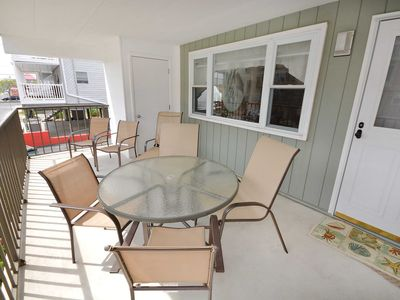 Photo for Spacious and comfortable 2-bedroom condo with free WiFi and flatscreen TVs located uptown and just a half a block to the beach!