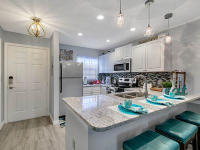 Photo for Luxury townhome -Free Water park- 3 pools- lazy river & more! 4 miles to Disney