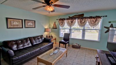 Photo for Fabulous Condo steps from BEACH and next door to  SCHLITTERBAHN