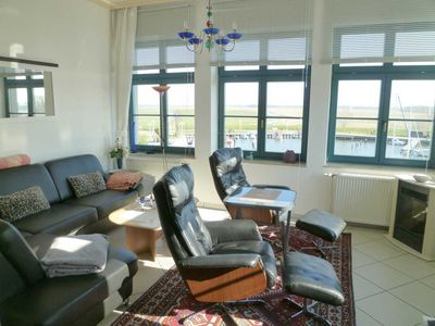 Photo for Sonnenfewo directly on the water, kilometer-wide water view - apartment Sonnenresidenz, direct water situation at the port, 2 beds.