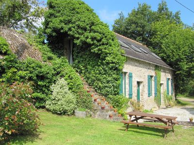 Photo for A converted stone Barn, sleeps 7 in 4 acres of garden with heated swimming pool