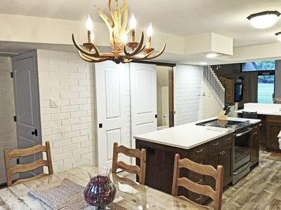 The Dining Room is conveniently next to the Kitchen island.