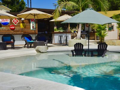 Photo for Sunshine and privacy in a resort style setting with pool/jacuzzi and outdoor bar