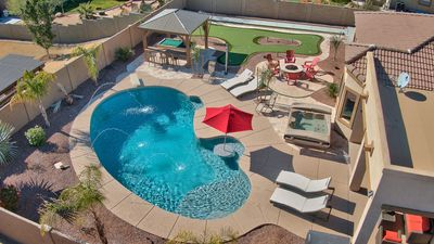 Very Large Heated Diving Pool with built in table and seating and Deck Jets