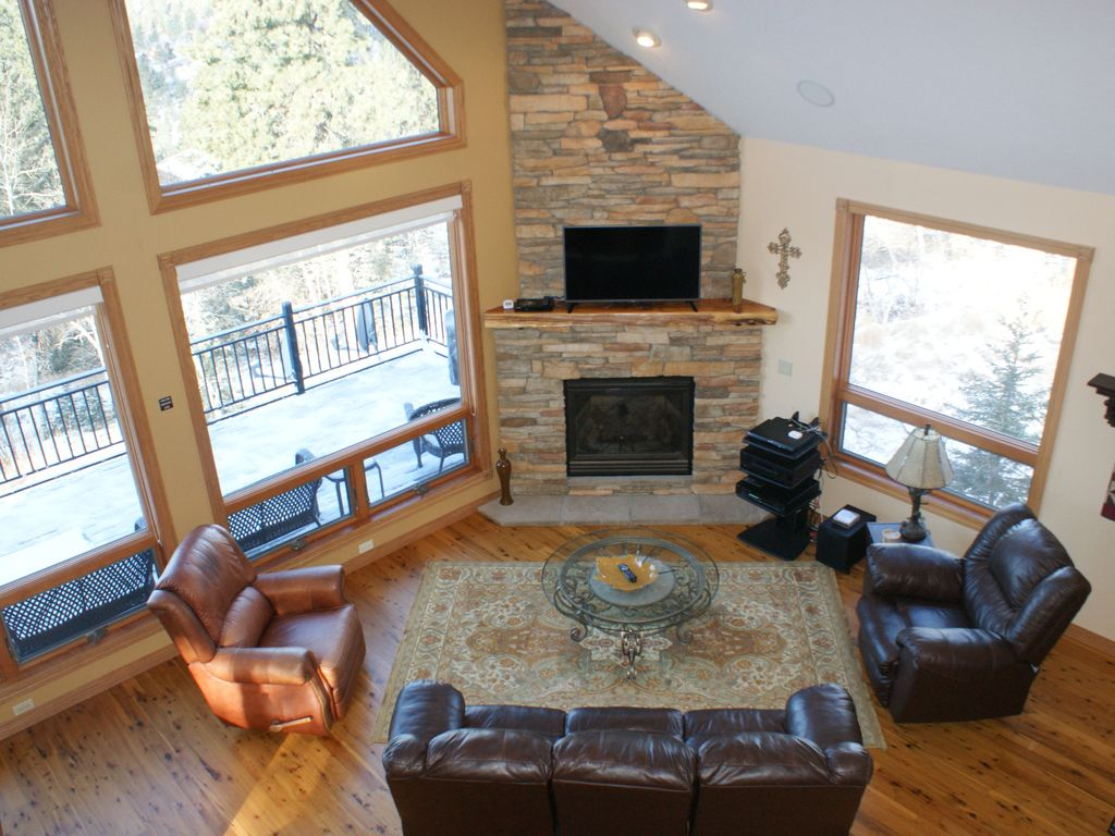 Great Room Is Adjacent To The Main Deck With Grill And Patio Furniture.