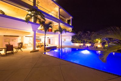 Night lights of the house and swimming pool terrace