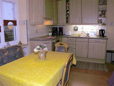 The cozy and comfortable eat-in kitchen