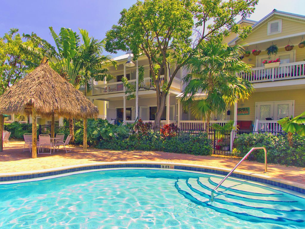 stunning heated pool with shaded tiki hut island days   spacious   coral hammock   ho      vrbo  rh   vrbo