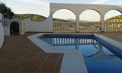 Swimming pool with beautiful views through terrace arches