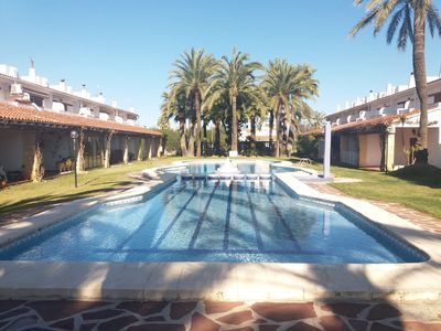 Photo for Townhouse for 6 pers. with communal pool and gardens, just 400m from the beach