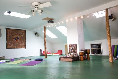 The Yoga room - mats, blankets, instruments, and projector and stereo