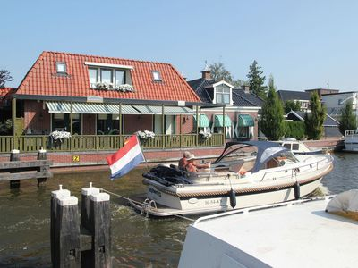Photo for An unique holiday home by the water with a view of the boats at Delftstrahuizen