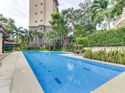 Photo for Modern condo w/ shared pool, gym, nice views - walk to the beach!