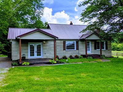 Photo for Secluded Creekside farmhouse