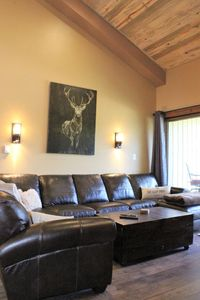 Large leather sectional  is perfect for watching TV in front of the fireplace