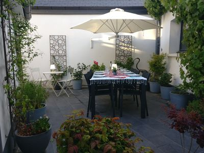 Photo for Double house with patio in a quiet town in a medieval quarter with easy parking
