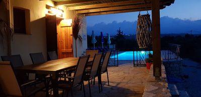 Fabulous night time dining by the pool at Villa Selene