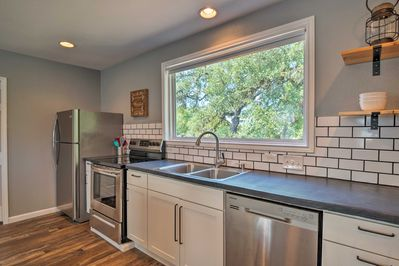 The cottage includes a contemporary-style fully equipped kitchen.