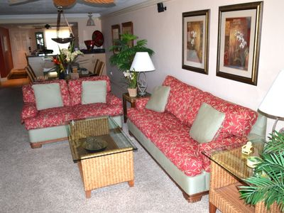 Living room and dining room are professionally decorated with tropical furniture