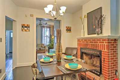The dining room features a wood burning fireplace for some cozy meals at home.
