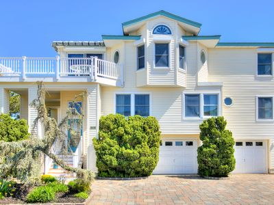 Photo for Gorgeous bay views from living area and all decksin an immaculate reverse living hom