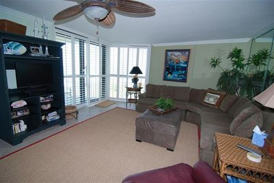 Newly remodeled Living Room with a beach view and flat screen TV.
