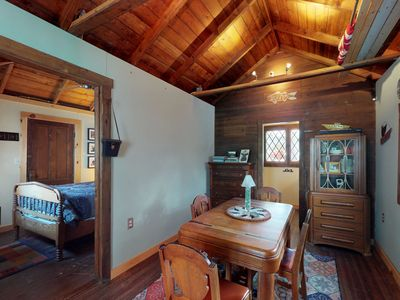 Photo for Cozy lakefront cabin w/ deck, beach access, & outdoor shower