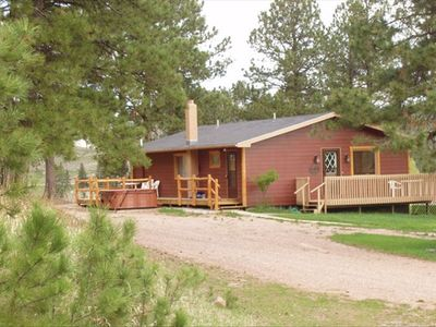 Tin Mill Cottage on a quiet wooded lot, walking distance to downtown!