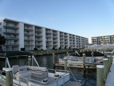 Photo for Beautiful 2br/2ba direct bayfront with pool and boat slip