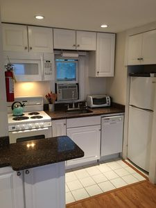 Fully stocked kitchen w/ dishwasher, microwave, coffee maker, stove/oven &more