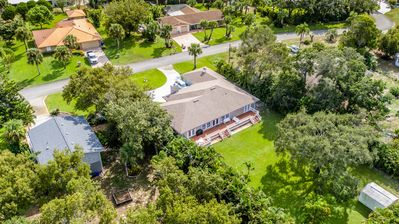 Great aerial shot of the property and  huge backyard.
