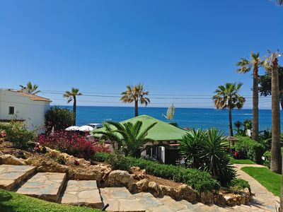 Photo for Beachfront apartment with amazing views & newly renovated with WiFi and int. TVs
