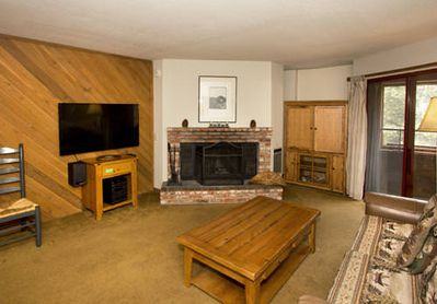 Living room with cabin decor and fireplace
