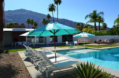Six Chaise Lounges with many seating areas near pool